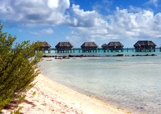Polynesian landscape -small houses on water. Royalty Free Stock Image