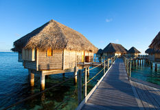 Polynesian landscape -small houses on water. Stock Photography
