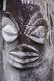 Polynesian male figurine rock carving in basalt sculpture. Carving was an important part of ancient Cook Islands culture, although much of this is lost Stock Photography