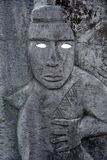 Polynesian male figurine rock carving in basalt sculpture. Carving was an important part of ancient Cook Islands culture, although much of this is lost Stock Photos
