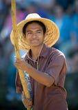 Polynesian man on canoe Stock Photography