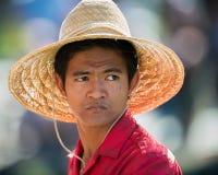 Polynesian man under large straw hat Stock Photo