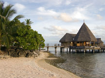 Polynesian Overwater. Overwater bungalows in Tikehau, Polynesia, with a pink sand beach Stock Images