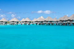 Polynesian overwater bungalows in Bora Bora Stock Photo