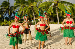 Polynesian Pacific Island Tahitian Dance Group. Group portrait of Polynesian Pacific Island Tahitian dance group in colorful costumes dancing on tropical beach Stock Images