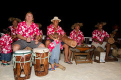 Polynesian Pacific Island Tahitian Music Group. Portrait of Polynesian Pacific Island Tahitian music group in colorful outfit in play music on tropical beach royalty free stock photography