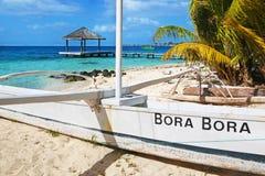 Polynesian sailboat on Bora Bora beach. Polynesian white sailboat on Bora Bora tropical beach Stock Images