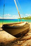 Polynesian scene. A small boat rests on the beach of a Polynesian Island Royalty Free Stock Images