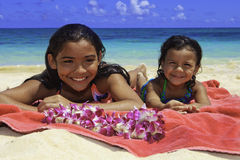 Polynesian sisters at the beach Royalty Free Stock Photos