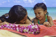 Polynesian sisters at the beach Stock Photos