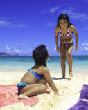 Polynesian sisters at the beach Royalty Free Stock Photo