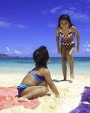 Polynesian sisters at the beach Royalty Free Stock Photo