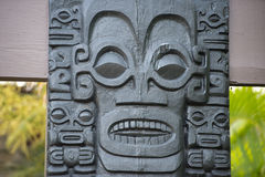 Polynesian stone statue. Polynesian statue close up detail Royalty Free Stock Images