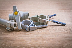 Polypropylene Fixators And  Pipe  With Clips Water Royalty Free Stock Image