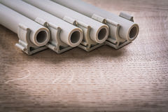 Polypropylene Pipe With Clips On Wooden Board Stock Photo