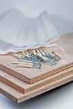 Polypropylene sheet pile of screws plugs Stock Photography
