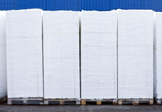 Polystyrene boxes. Lots of white polystyrene boxes piled up on transport palettes Royalty Free Stock Images