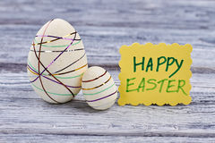 Polystyrene eggs and Easter card. White styrofoam eggs with ribbons stock photos