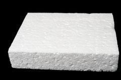 Polystyrene foam. A piece of polystyrene foam isolated on black background Stock Photo