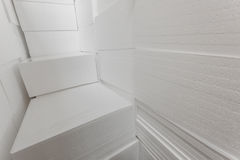 Polystyrene insulation boards. Polystyrene plates warehouse. Polystyrene Stack Royalty Free Stock Photography