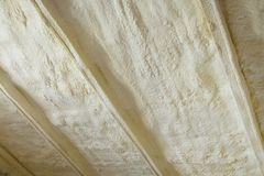 Polyurea Spraying, foam coating insulation of roof. Polyurea Spraying, foam coating insulation of roof stock images