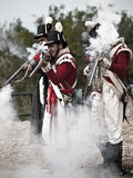 Pom Musketeers. MTARFA, MALTA - MAY 23 - British soldiers fire muskets during reenactment in Mtarfa Malta on May 23rd, 2010 Royalty Free Stock Photos