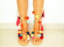 Pom pom bohemian sandals Stock Photos