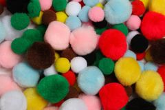 Pom-poms multicolored  background stock photos