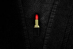 Pomade on black cloth background. Red pomade lies on a black terry cloth Stock Photo