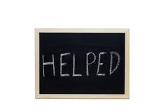 POMAGAĆ pisać z biel kredą na blackboard Obrazy Royalty Free