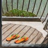 Pomarańcz klapy kłama przy domowym wejściem Obrazy Stock