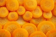Pomarańcz marchewek pokrojony tło Zdjęcie Stock