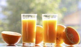 Pomarańcze i sok pomarańczowy Obrazy Royalty Free