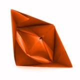 Pomarańcze papierowy naczynie, origami żagla łódź odizolowywająca na białym tle Zdjęcia Royalty Free