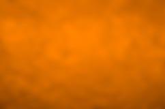 Pomarańcze tekstury abstrakta stonowany tło Obrazy Stock