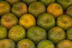 Pomarańcze utrzymywać w wzorze dla pokazu Zdjęcia Royalty Free