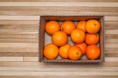 Pomarańcze w pudełku dla tła Obraz Royalty Free