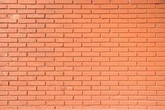 Pomarańczowa cegły ściana Zdjęcia Stock
