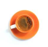 Pomarańczowa filiżanka kawy Zdjęcia Royalty Free