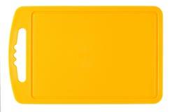 Pomarańczowa plastikowa tnąca deska Fotografia Royalty Free