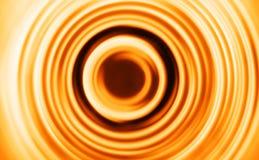 Pomarańczowa ruch plama teleportuje zawijasa tło Obrazy Stock