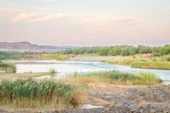 Pomarańczowa Rzeczna Namibia i Południowa Afryka granica Zdjęcia Stock