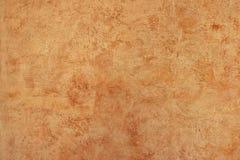Pomarańczowa szorstka tekstura na ścianie Obraz Stock