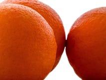 Pomarańczowe owoc odizolowywać na białym tle zamkniętym w górę obraz stock