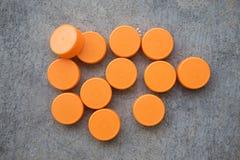 Pomarańczowe plastikowe butelek nakrętki Obraz Royalty Free