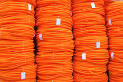 Pomarańczowe wąż elastyczny zwitki Zdjęcia Stock