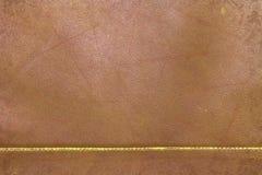 Pomarańczowego grunge stara podława skóra z szwu wzorem Zdjęcie Stock