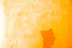 Pomarańczowego koloru stara ścienna tekstura Obrazy Stock