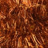 Pomarańczowego złocistego colour świecidełka tła Bożenarodzeniowy szczegół Zdjęcia Royalty Free