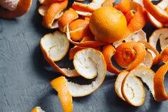 Pomarańczowej łupy mandarynki tło tangerines odgórny widok Obraz Royalty Free
